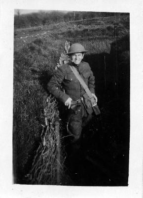 Soldier Poses in a Trench
