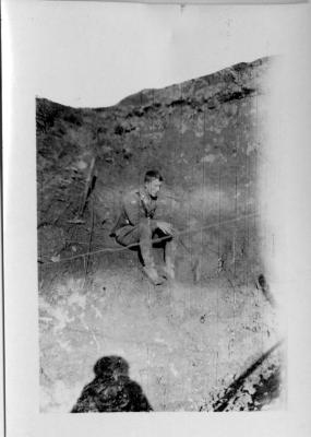 Lieutenant James A McGuire in Shell Hole
