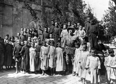 Photograph of Dr. John H. Finley of the Armenian Relief Effort with Armenian Children